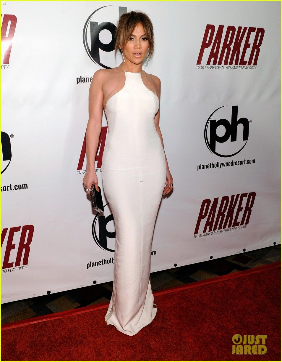 Jennifer Lopez hits the red carpet in a white dress with slits down the side at the premiere of her film Parker on Thursday (January 24) at Planet Hollywood in Las Vegas, Nev.