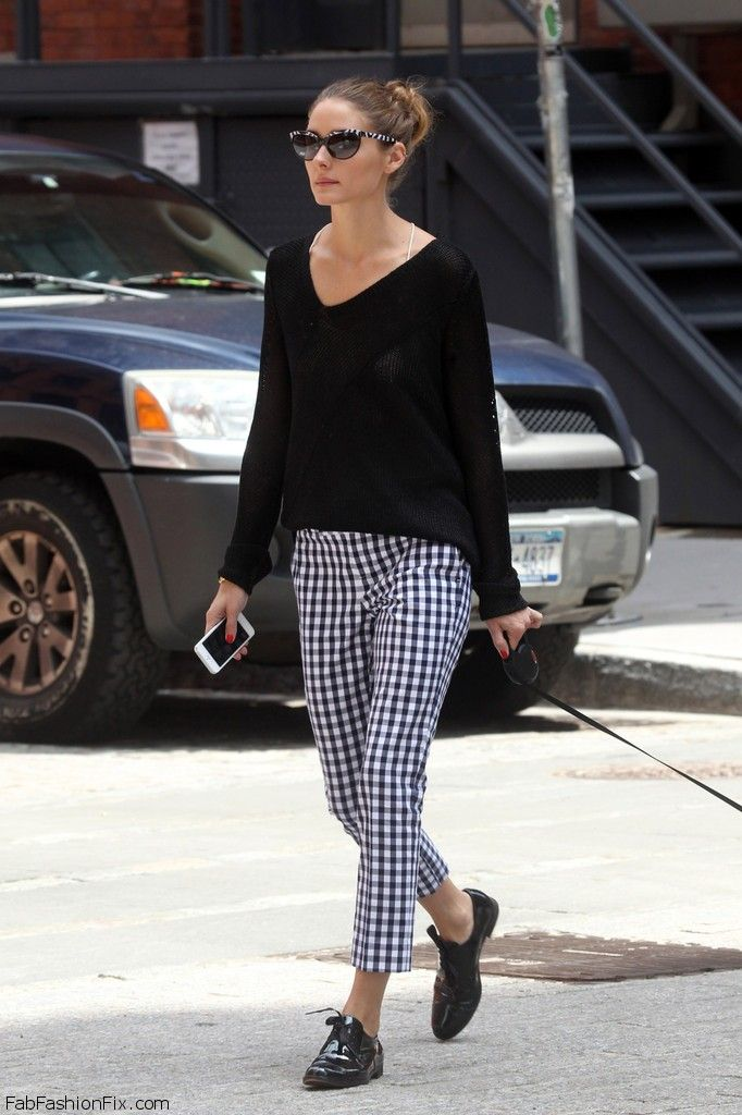 Olivia Palermo goes casual in a loose black sweater and checkered pants while walking her dog in New York City. Jun 11, 2013
