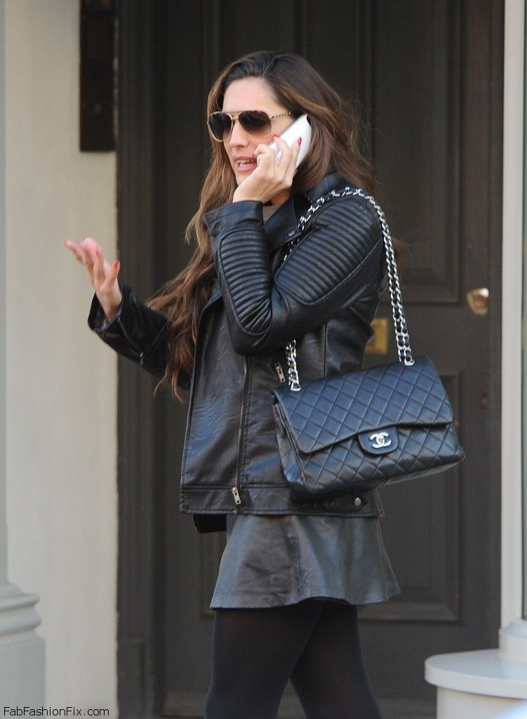 She Is Wearing Nothing–Save for a Chanel Bag
