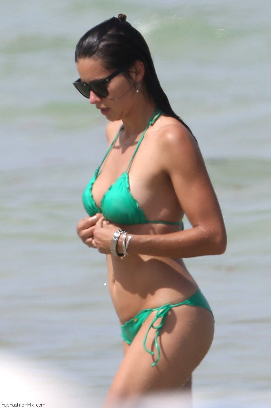 Newly single Adriana Lima wears a green bikini to the beach in Miami