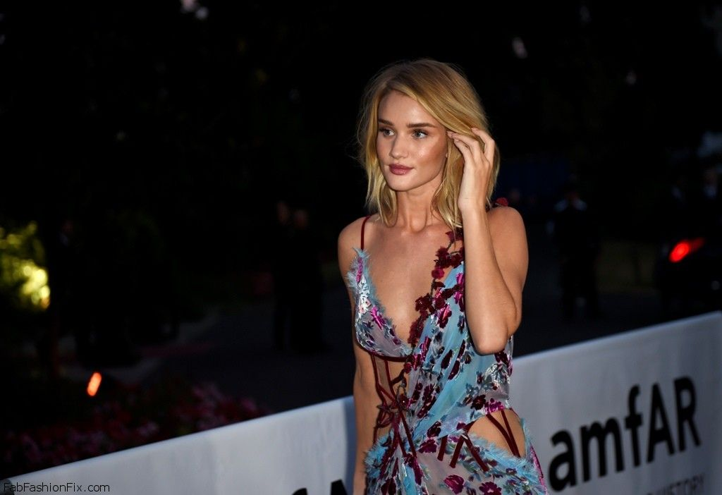 British model and actress Rosie Huntington-Whiteley arrives to take part in the Amfar dinner on the sidelines of the Paris fashion week on July 5, 2015 in Paris.    AFP PHOTO / LOIC VENANCE