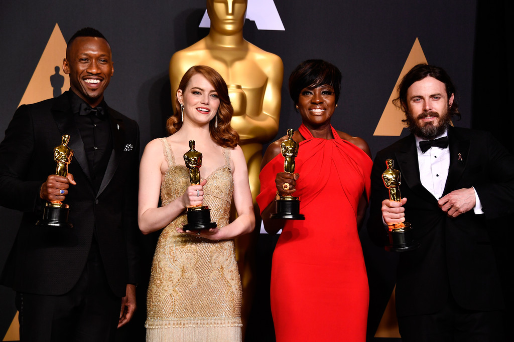 Actors Mahershala Ali, winner of Best Supporting Actor for 'Moonlight,' Emma Stone, winner of Best Actress for 'La La Land,' Viola Davis, winner of the Best Supporting Actress award for 'Fences,' and Casey Affleck, winner of Best Actor for 'Manchester by the Sea,' pose in the press room during the 89th Annual Academy Awards at Hollywood & Highland Center on February 26, 2017 in Hollywood, California.