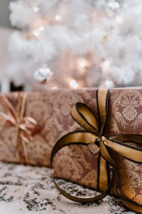 elegantly wrapped gifts with golden ribbon