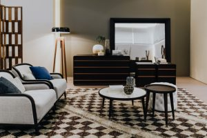 Luxury living room interior with table, archairs, commode, lamp, rug